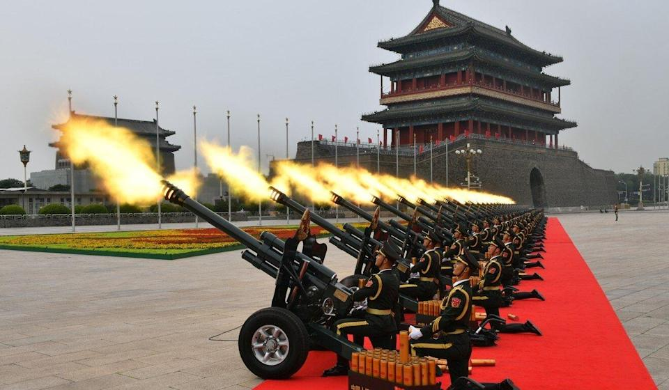 The day began with a 100-gun salute. Photo: Xinhua