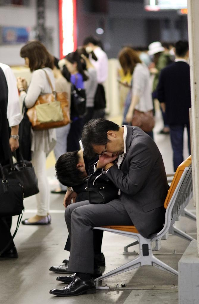 Hundreds of deaths related to overwork are reported every year in Japan, along with a host of serious health problems, sparking lawsuits and calls to tackle the problem (AFP Photo/Yoshikazu Tsuno)