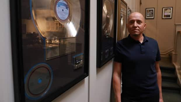 Armoury Studios manager Paul Silveira says the company has lost time and money due to radio interference and he's concerned it could potentially tarnish its reputation. (CBC News/ Jim Mulleder - image credit)