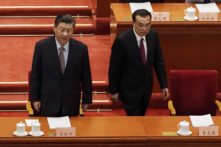 Chinese President Xi Jinping, left, and Premier Li Keqiang arrive for the opening session of Chinese People's Political Consultative Conference (CPPCC) at the Great Hall of the People in Beijing, Thursday, March 4, 2021. (AP Photo/Andy Wong)