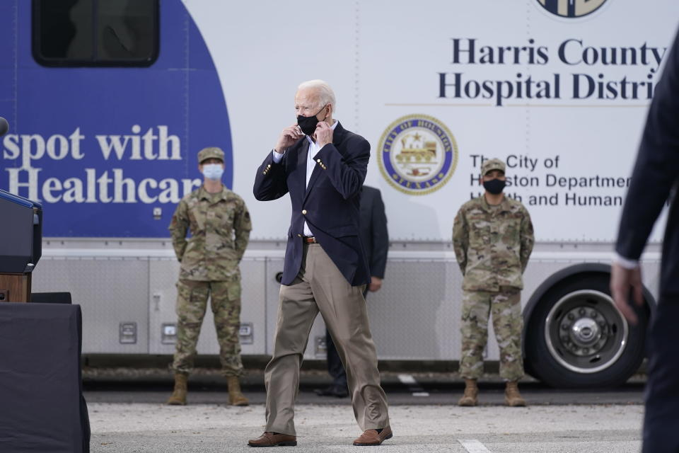 President Joe Biden arrives to speak at a FEMA COVID-19 mass vaccination site at NRG Stadium, Friday, Feb. 26, 2021, in Houston. (AP Photo/Patrick Semansky)