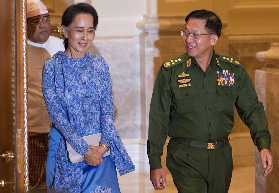File image: In this file photo taken on 30 March, 2016, Aung San Suu Kyi and Myanmar military chief Senior General Min Aung Hlaing (R) arrive for a handover ceremony at the presidential palace in Naypyidaw (POOL/AFP via Getty Images)