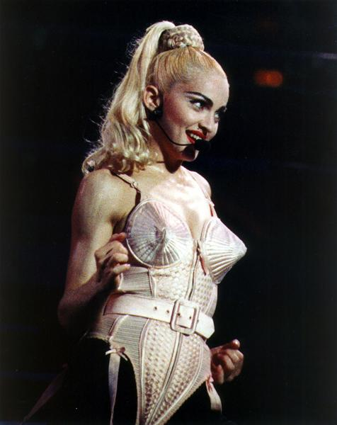 "<div class=""caption-credit""> Photo by: AP</div><div class=""caption-title""></div><b>""Blonde Ambition"" tour in Philadelphia, 1990</b> <br> Madonna debuted her now-famous cone bra, designed by Jean Paul Gaultier. Her tight, high (fake) ponytail, dark brows, and red lips are equally noteworthy."