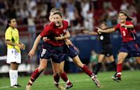 <p>The United States women's soccer team, led by players Abby Wambach and Mia Hamm, beat Brazil 2-1 in overtime, securing a gold medal victory after an intense back and forth.</p>