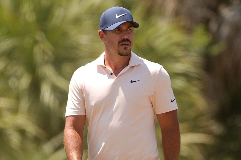 Professional golfer Brooks Koepka in a Nike hat and polo
