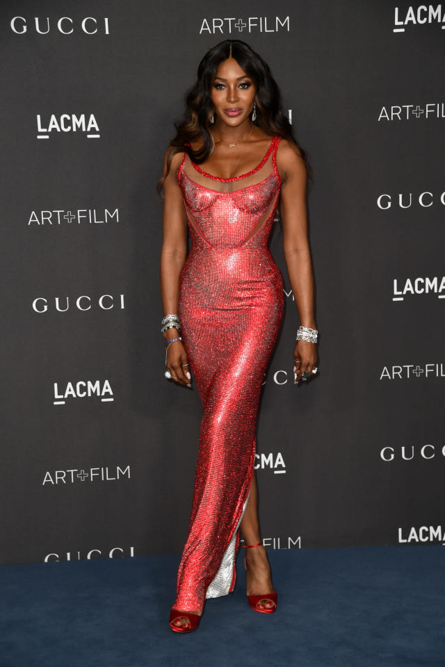 Campbell opted for a new take on her usually slick straight hair by adding some loose waves to her look for the LACMA Art + Film Gala. The Atelier Versace scoop neck fitted gown looked great against diamond cuffs and earrings. [Getty Images]