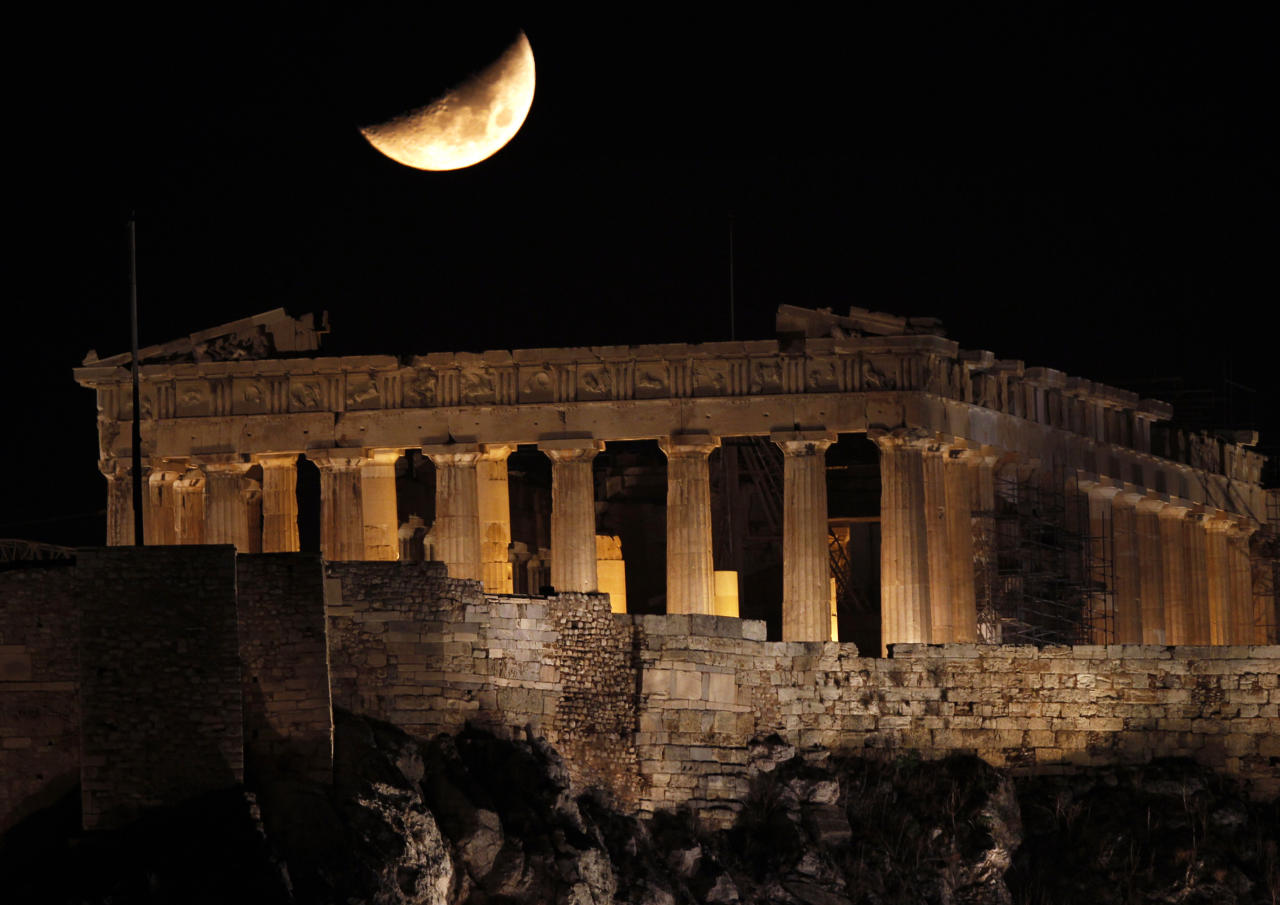 A crescent moon is seen over the Parthenon atop Athens' ancient Acropolis November 1, 2011.  (REUTERS/Yannis Behrakis)