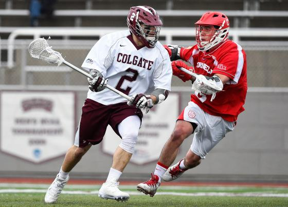 Tyler Rigo #2 of the Colgate Raiders dodges to the goal against the defense of Matt Schattner #8 of the Cornell Big Red during the fourth quarter at Andy Kerr Stadium on March 15, 2016 in Hamilton, New York. Cornell won 6-5.