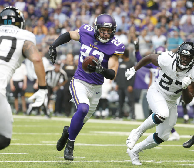 FILE - In this Aug. 18, 2018, file photo, Minnesota Vikings defensive back Harrison Smith (22) runs up field between Jacksonville Jaguars' James O'Shaughnessy, left, and Leonard Fournette, right, after intercepting a pass during the first half of an NFL preseason football game, in Minneapolis. The Vikings play at the Green Bay Packers on Sunday, Sept. 16. (AP Photo/Bruce Kluckhohn, File)