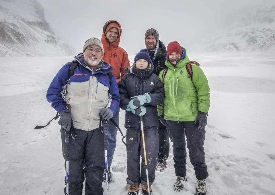 Greta Thunberg (centre) with scientists on Canada's Athabasca Glacier (Mark Ferguson/BBC/PA)