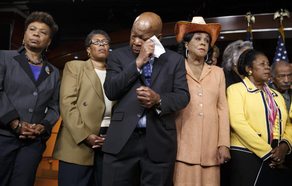 Civil right leader Rep. John Lewis, D-Ga., center, wipes his eyes as members of the Congressional Black Caucus make emotional statements condemning the slayings of police officers in Dallas last night, and the fatal police shootings of black men in Louisiana and Minnesota earlier in the week, during a news conference on Capitol Hill in Washington on July 8, 2016. From left are: Rep. Barbara Lee, D-Calif., Rep. Marcia L. Fudge, D-Ohio, Rep. John Lewis, D-Ga., Rep. Frederica Wilson, D-Fla., and Rep. Sheila Jackson Lee, D-Texas. (Photo: J. Scott Applewhite/AP)
