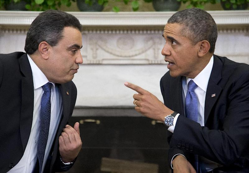President Barack Obama meets with Tunisian Prime Minister Mehdi Jomaa, Friday, April 4, 2014, in the Oval Office of the White House in Washington. (AP Photo/Carolyn Kaster)