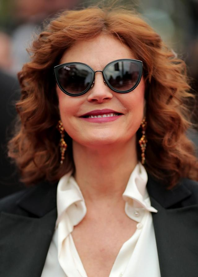 <p>Sarandon is one shady lady at Cannes. The legendary actress kept her eyes covered but allowed her copper waves to flow in the wind, with her tresses working perfectly with her red lipstick. (Photo: Getty Images) </p>