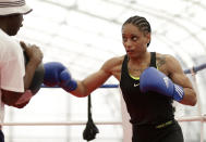 United States' 60-kg lightweight boxer Queen Underwood warms up during a women's boxing practice session at the 2012 Summer Olympics, Thursday, July 26, 2012, in London. (AP Photo/Patrick Semansky)