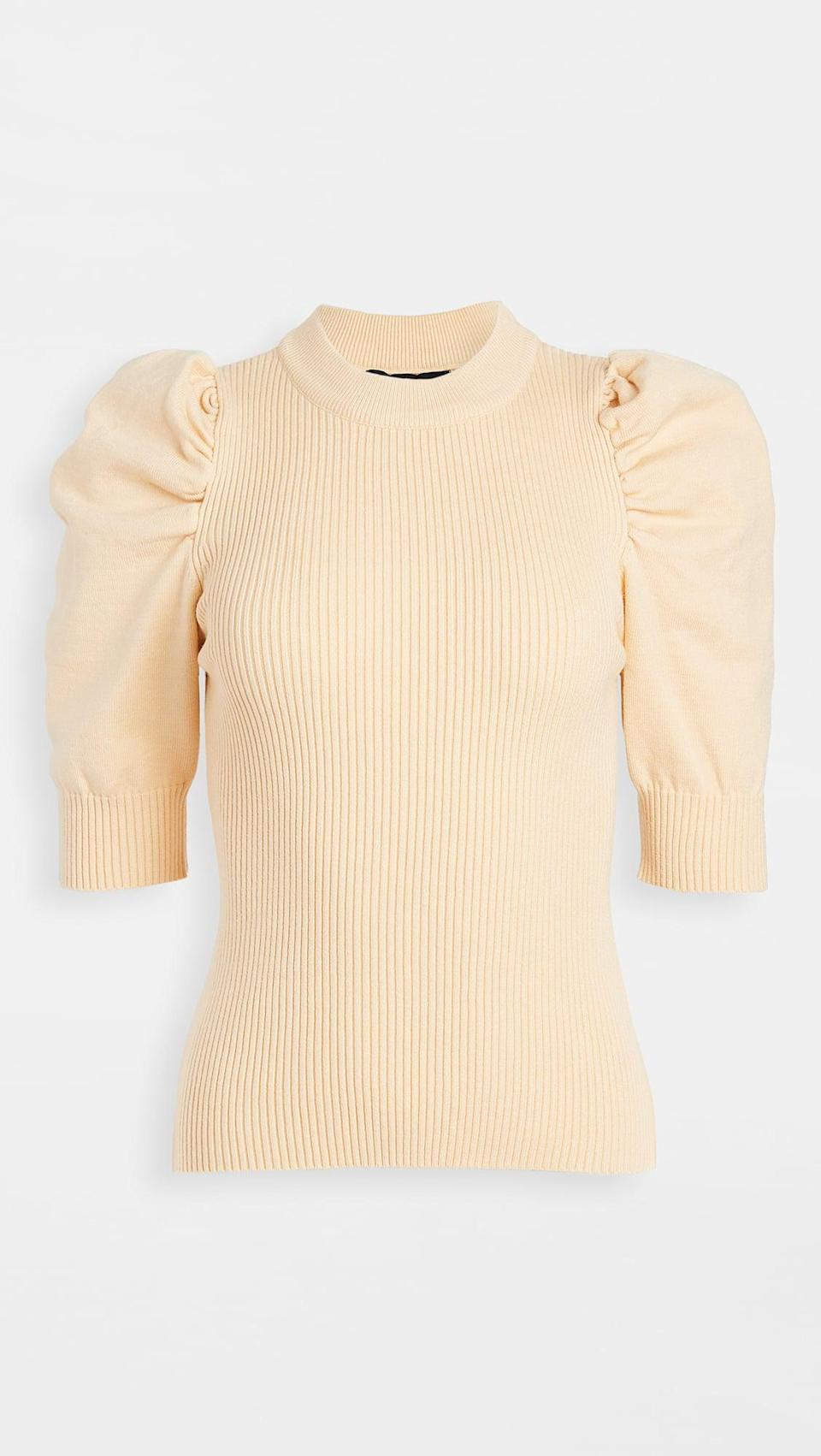 <p>This <span>En Saison Puff Sleeve Sweater Top</span> ($55, originally $78) is the perfect office-to-happy-hour formula.</p>