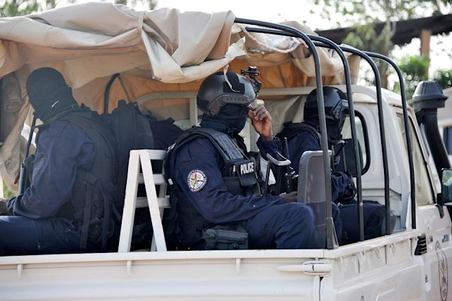 <p>Malian police forces enter the Kangaba tourist resort in Bamako on June 19, 2017, a day after suspected jihadists stormed the resort, briefly seizing more than 30 hostages and leaving at least two people dead. (Habibou Kouyate/AFP/Getty Images) </p>