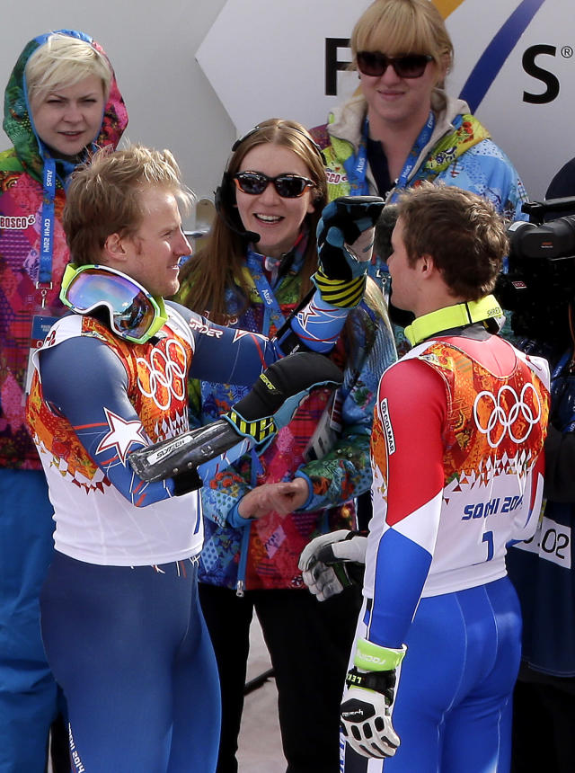 Men's giant slalom medalists, United States' Ted Ligety, left, jokingly fixes bronze medalists' France's Alexis Pinturault hair as they prepare for the flower ceremony at the Sochi 2014 Winter Olympics, Wednesday, Feb. 19, 2014, in Krasnaya Polyana, Russia. (AP Photo/Charlie Riedel)