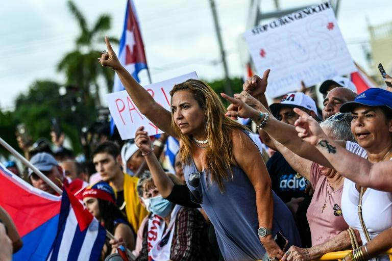 Naima Pineda gestures as she protests to show support for Cubans demonstrating against their government, in Miami, Florida.
