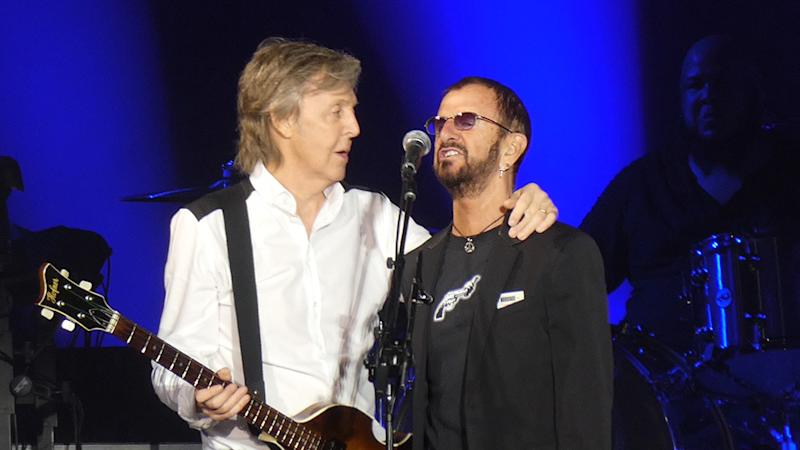 I love you, man': Paul McCartney and Ringo Starr reunite onstage in L A