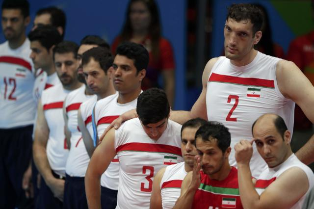 2016 Rio Paralympics - Sitting Volleyball - Final - Men's Gold Medal Match - Riocentro Pavilion 6 - Rio de Janeiro, Brazil - 18/09/2016. Players of team Iran observe a minute of silence for Iranian cyclist Sarafraz Bahman Golbarnezhad, REUTERS/Ueslei Marcelino FOR EDITORIAL USE ONLY. NOT FOR SALE FOR MARKETING OR ADVERTISING CAMPAIGNS.
