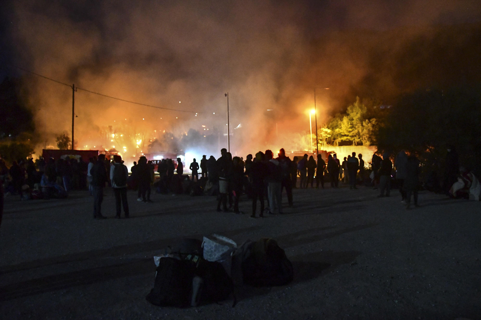Small fire burns tents in squalid Greek island refugee camp