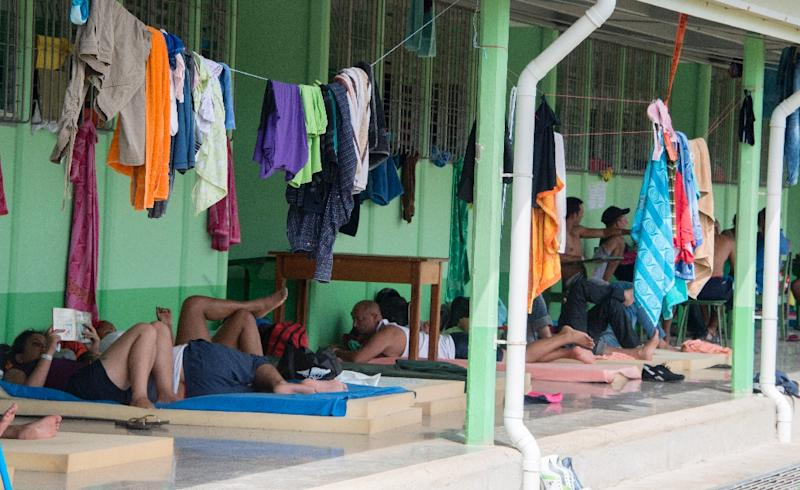 Cubans rest in a shelter in La Cruz, Guanacaste, Costa Rica, near the border with Nicaragua on November 26, 2015