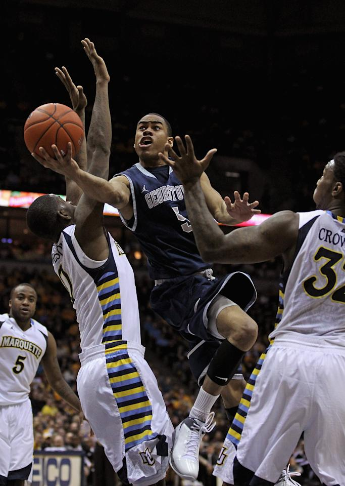 MILWAUKEE, WI - MARCH 03: Markel Starks #5 of the Georgetown Hoyas drives between Jamil Wilson #0 (L) and Jae Crowder #32 of the Marquette Golden Eagles at the Bradley Center on March 3, 2012 in Milwaukee, Wisconsin. Marquette defeated Georgetown 83-69.(Photo by Jonathan Daniel/Getty Images)