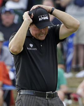 Phil Mickelson reacts after missing an eagle putt on the seventh hole during the final round of the PGA Championship. (AP)
