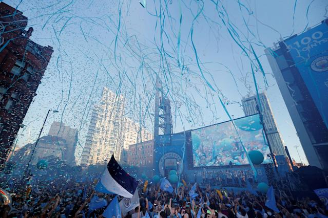 Soccer Football - Premier League - Manchester City Premier League Title Winners Parade - Manchester, Britain - May 14, 2018 Manchester City fans and players celebrate during the parade Action Images via Reuters/Andrew Boyers TPX IMAGES OF THE DAY