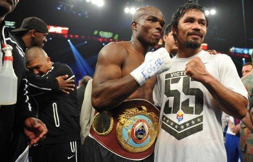 Timothy Bradley (L) of the US celebrates his victory over Manny Pacquiao of the Philippines following their WBO welterweight title match at the MGM Grand Arena, on June 9, in Las Vegas, Nevada. Unbeaten Bradley ended Pacquiao's long unbeaten run with a controversial split decision victory over the Filipino ring icon