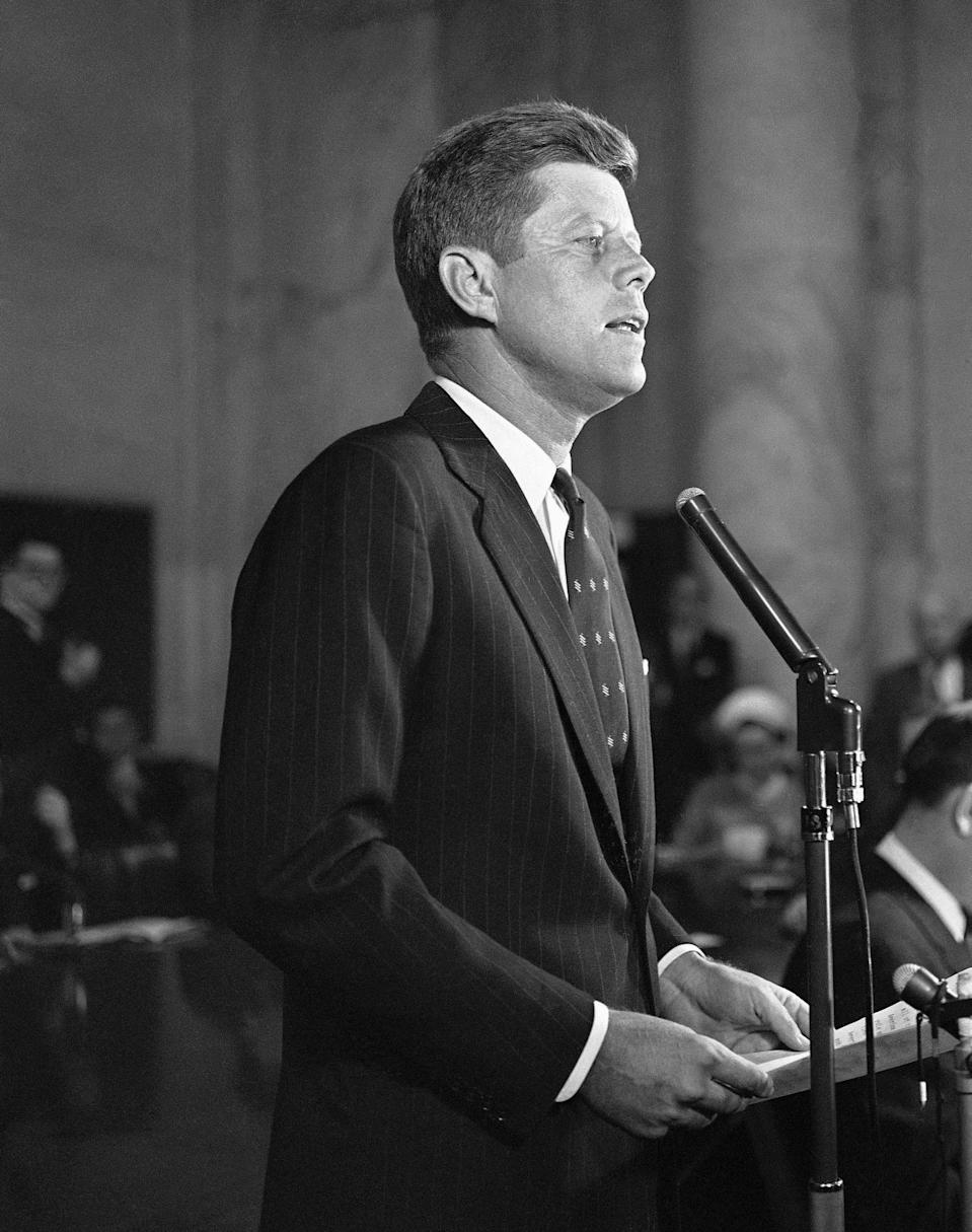 FILE - In this Jan. 2, 1960, file photo, Sen. John F. Kennedy, D-Mass., formally announces at a news conference in Washington that he is a candidate for the Democratic presidential nomination. A handwritten draft Kennedy's announcement speech is among hundreds of items associated with the late president to be auctioned in January 2020, by the Boston-based RR Auction. Online bidding for the collection put together by a California man opens Jan. 17. (AP Photo, File)