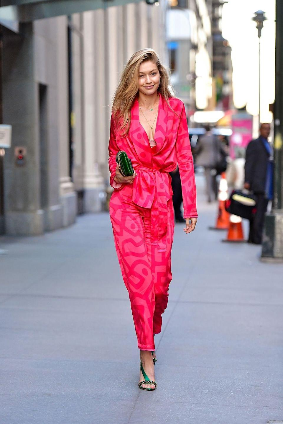 <p>Well, the just-rolled-out-of-bed look will never be the same again. Gigi dominated in a silky pajama-inspired jumpsuit and green accessories with zero makeup. </p>
