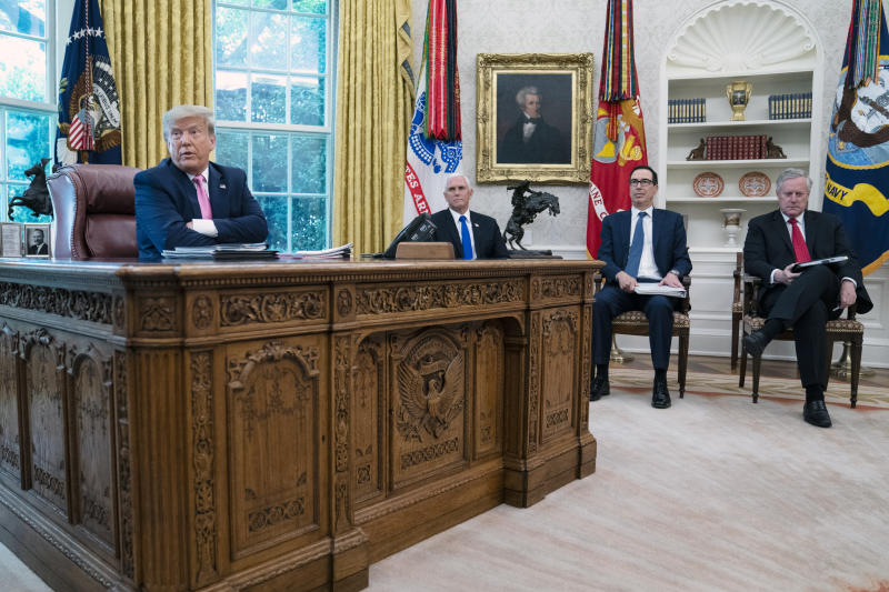 President Donald Trump speaks during a meeting with Senate Majority Leader Mitch McConnell of Ky., and House Minority Leader Kevin McCarthy of Calif., in the Oval Office of the White House, Monday, July 20, 2020, in Washington. From left, Trump, Vice President Mike Pence, Treasury Secretary Steven Mnuchin, and White House chief of staff Mark Meadows. (AP Photo/Evan Vucci)