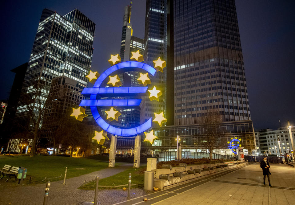 A man walks past the Euro sculpture in Frankfurt, Germany, Thursday, March 11, 2021. The European Central Bank will have a meeting of the governing council on Thursday. (AP Photo/Michael Probst)
