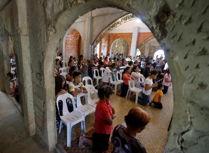 In this Jan. 27, 2019 photo, worshippers attend a Sunday Mass officiated by a substitute priest in the chapel built by U.S. priest Father Pius Hendricks in the village of Talustusan on Biliran Island in the central Philippines. Parishioners said Hendricks would ask children to occupy benches in front of the altar while saying Mass. (AP Photo/Bullit Marquez)