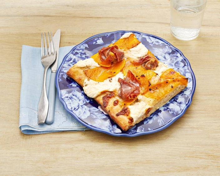 """<p>Butternut squash and prosciutto complement each other beautifully in this sweet, salty recipe.</p><p><strong><a href=""""https://www.thepioneerwoman.com/food-cooking/recipes/a32613045/white-pizza-with-butternut-squash-and-prosciutto-recipe/"""" rel=""""nofollow noopener"""" target=""""_blank"""" data-ylk=""""slk:Get the recipe."""" class=""""link rapid-noclick-resp"""">Get the recipe.</a> </strong> </p>"""