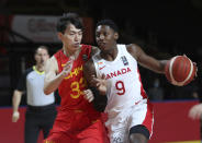 Canada's RJ Barrett protects the ball from China's Qian Wu during the first half of a FIBA men's Olympic basketball qualifying game Wednesday, June 30, 2021, in Victoria, British Columbia. (Chad Hipolito/The Canadian Press via AP)