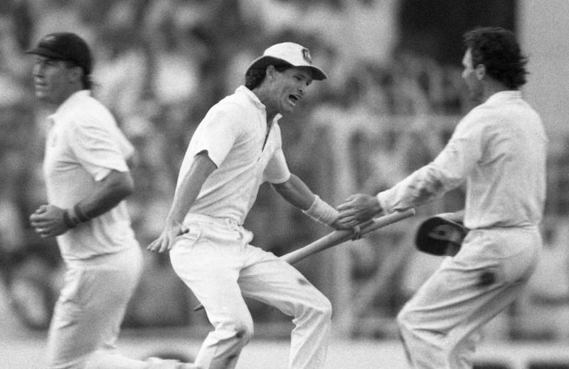 Jones celebrates with the Australian captain Allan Border at the end of the 1987 World Cup final, a seven-run victory against England - Liu Heung Shing/AP