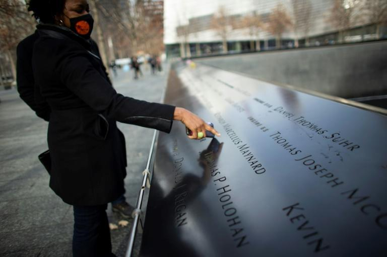 Janice Ryan pointing at the name of her friend who died in 9/11