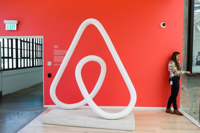 A woman talks on the phone at the Airbnb office headquarters in the SOMA district of San Francisco