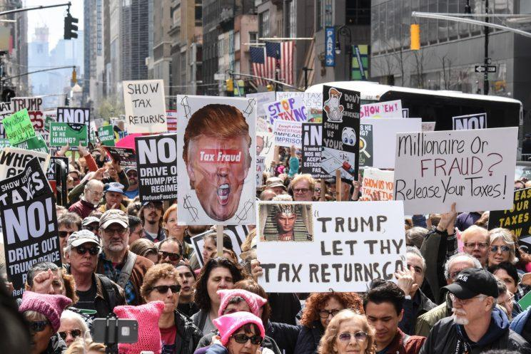 People participate in a Tax Day protest in New York City on Saturday. (Stephanie Keith/Getty Images)