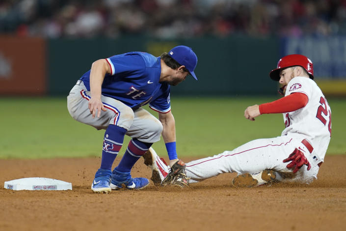 Los Angeles Angels' Jared Walsh, right, is out at second with a tag by Texas Rangers second baseman Nick Solak during the sixth inning of a baseball game Friday, Sep. 3, 2021, in Anaheim, Calif. (AP Photo/Ashley Landis)
