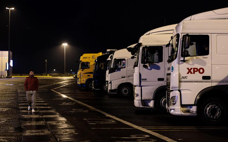 Lorries wait to board a ferry at the port of Dover in the early hours. Irish hauliers use Britain as a gateway to continental Europe.  - Getty Images Europe