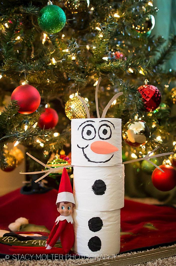 """<p>Here, paired with some orange construction paper, toilet paper becomes a snowman friend for your Elf—and if your kids are fans of <em>Frozen</em>, that friend can have a name: Olaf!</p><p><strong>Get the tutorial at <a href=""""https://californiaunpublished.com/45-amazingly-easy-elf-on-the-shelf-ideas-for-busy-moms/"""" rel=""""nofollow noopener"""" target=""""_blank"""" data-ylk=""""slk:California Unpublished"""" class=""""link rapid-noclick-resp"""">California Unpublished</a>.</strong> </p>"""