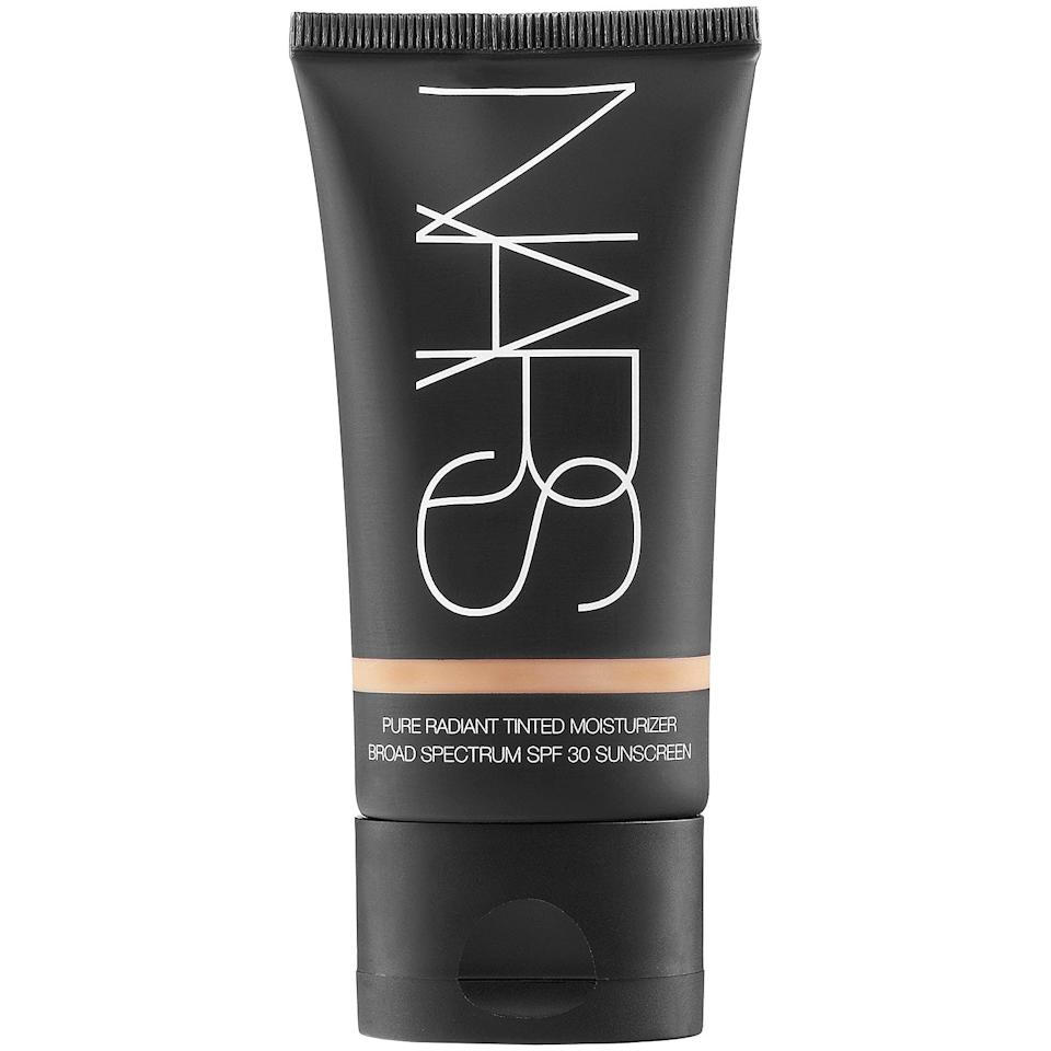 """<p><a href=""""https://www.popsugar.com/buy/NARS-Pure-Radiant-Tinted-Moisturizer-Broad-Spectrum-SPF-30-487173?p_name=NARS%20Pure%20Radiant%20Tinted%20Moisturizer%20Broad%20Spectrum%20SPF%2030&retailer=sephora.com&pid=487173&price=45&evar1=bella%3Aus&evar9=46575198&evar98=https%3A%2F%2Fwww.popsugar.com%2Fbeauty%2Fphoto-gallery%2F46575198%2Fimage%2F46575202%2FNARS-Pure-Radiant-Tinted-Moisturizer-Broad-Spectrum-SPF-30&list1=celebrity%20beauty%2Cnars%2Cbeauty%20products%2Cbeauty%20routine&prop13=mobile&pdata=1"""" rel=""""nofollow"""" data-shoppable-link=""""1"""" target=""""_blank"""" class=""""ga-track"""" data-ga-category=""""Related"""" data-ga-label=""""https://www.sephora.com/product/pure-radiant-tinted-moisturizer-spf-30-pa-P302923?skuId=1774645&amp;icid2=products%20grid:p302923:product"""" data-ga-action=""""In-Line Links"""">NARS Pure Radiant Tinted Moisturizer Broad Spectrum SPF 30</a> ($45)</p>"""