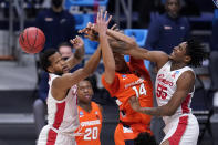 Houston forward Justin Gorham (4) Syracuse center Jesse Edwards (14) and Houston forward Brison Gresham (55) battle for the ball in the first half of a Sweet 16 game in the NCAA men's college basketball tournament at Hinkle Fieldhouse in Indianapolis, Saturday, March 27, 2021. (AP Photo/Michael Conroy)