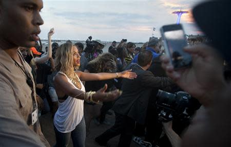 Singer Beyonce Knowles-Carter walks on the beach while filming a video at Coney Island in New York