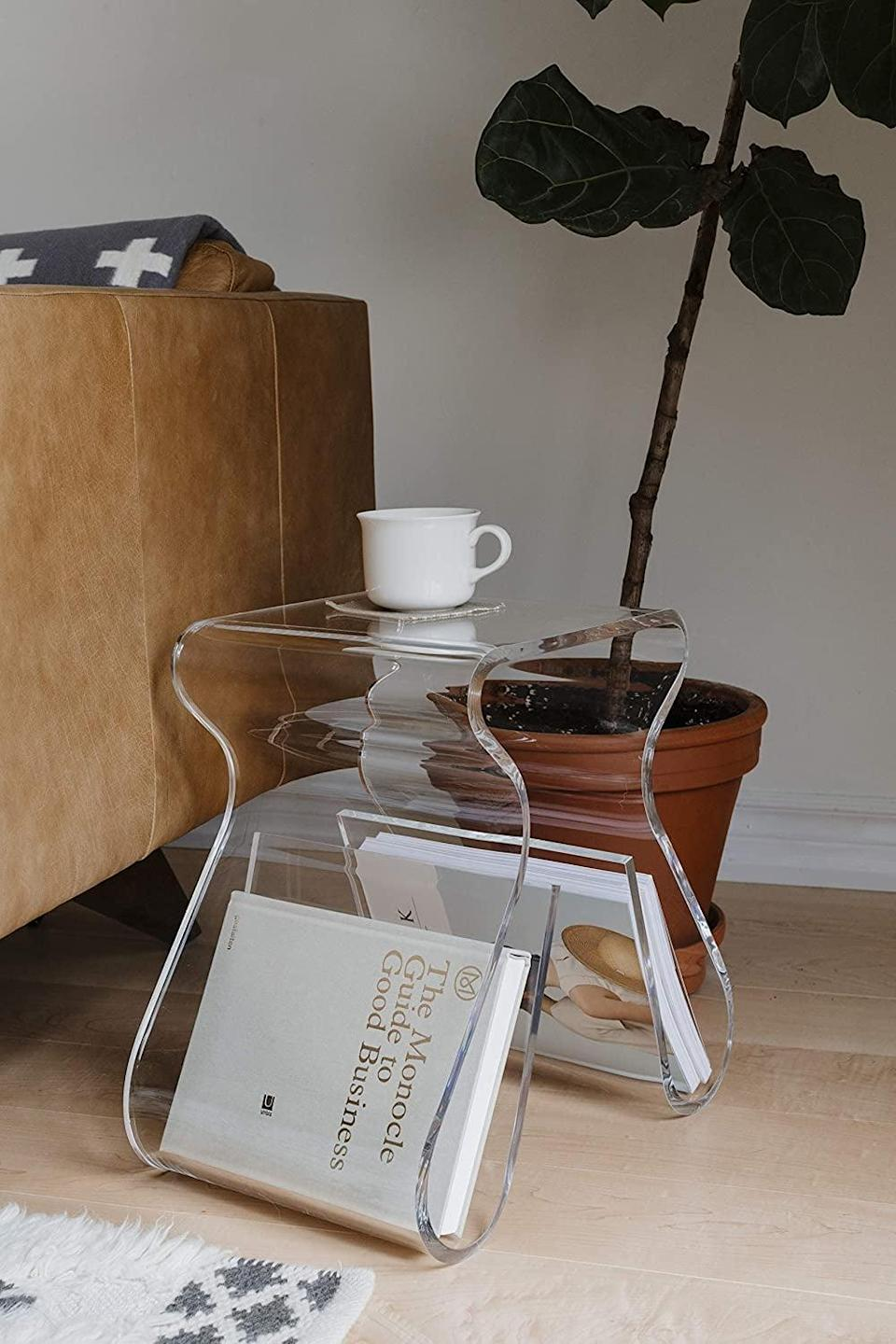 <p>The <span>Umbra Magino Acrylic Side Table</span> ($416) is perfect for books and magazines.</p>