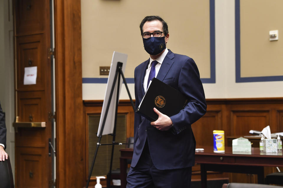 Treasury Secretary Steven Mnuchin arrives for a House Select Subcommittee on the Coronavirus Crisis during a hybrid hearing, Tuesday, Sept. 1, 2020, on Capitol Hill in Washington (Nicholas Kamm/Pool via AP)
