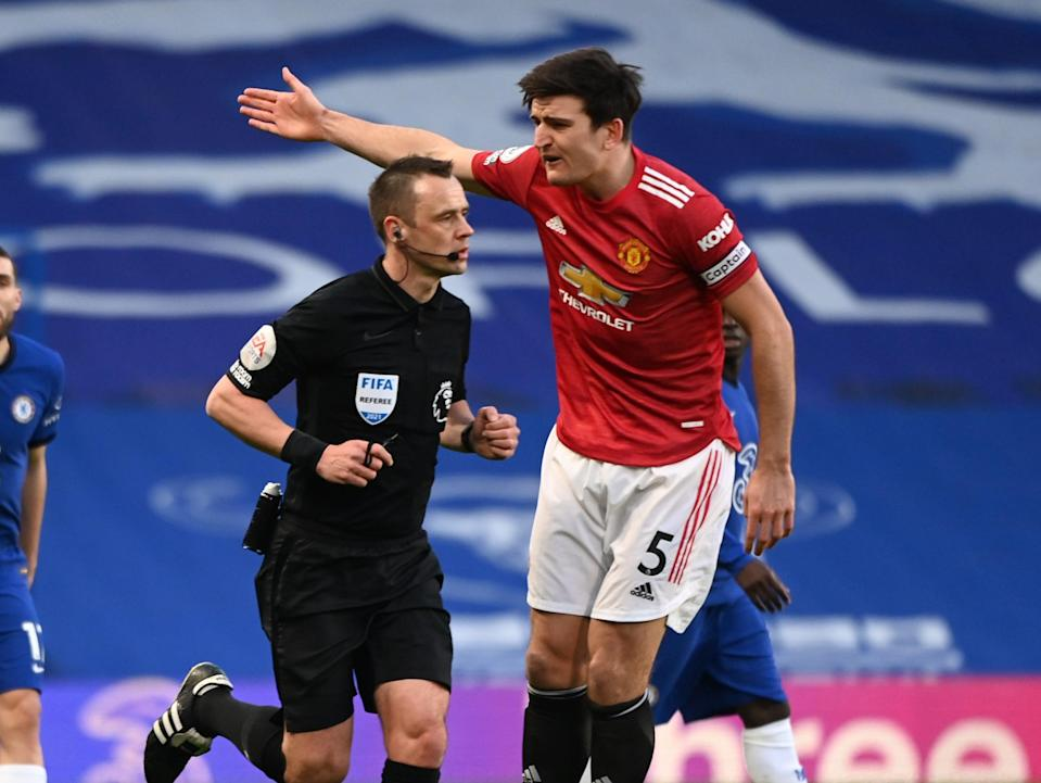 Referee Stuart Atwell and Manchester United captain Harry Maguire (Getty Images)